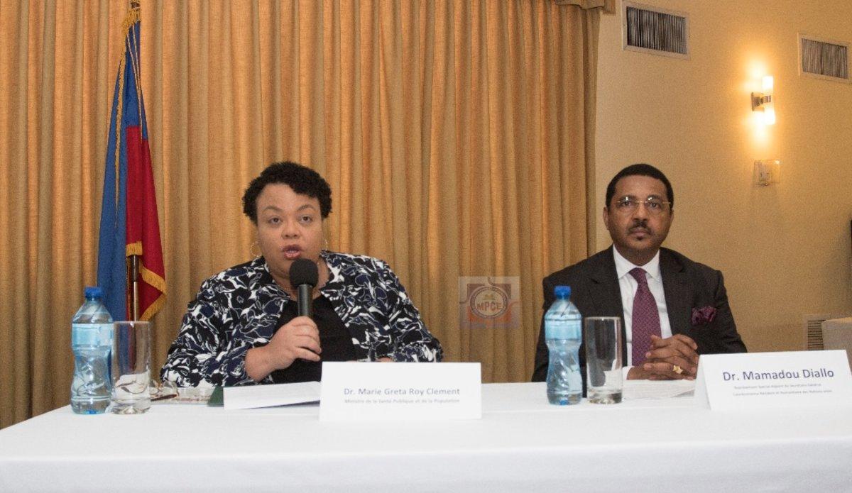 La Ministre a.i de la Planification et de la Coopération Externe, le Dr Marie Greta Roy Clément, et le Coordonnateur résident des Nations Unies en Haïti, le Dr Mamadou Diallo, lors de leur intervention. © MPCE